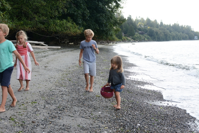 four walking on the beach