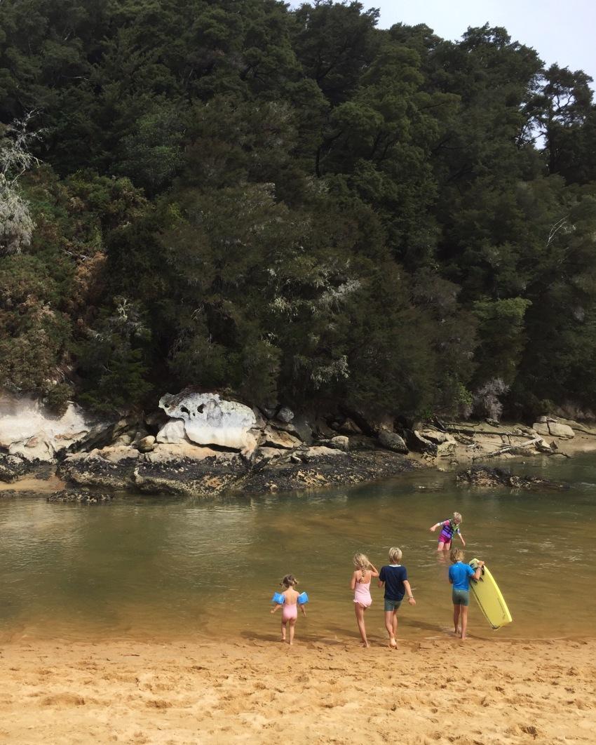 kids swimming in estuary
