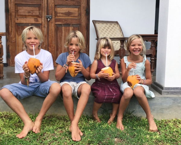 kids drinking coconuts
